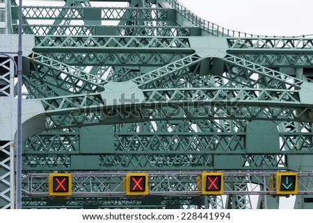 Beams joints and rivets on steel bridge closeup - stock photo