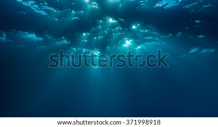Beams of light dapple the Ocean surface underwater. Malapascua, Philippines, November. - stock photo