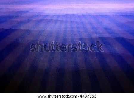 Beams of light over purple mountains - stock photo