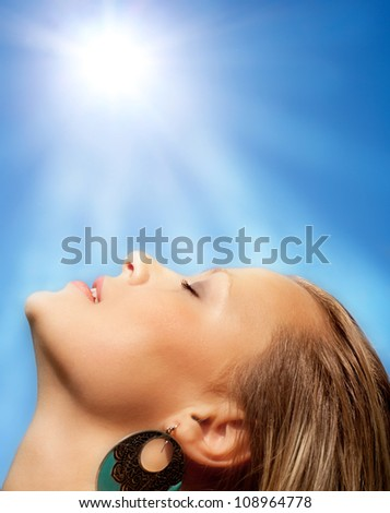 Beams of the sun and beautiful face of the girl. - stock photo