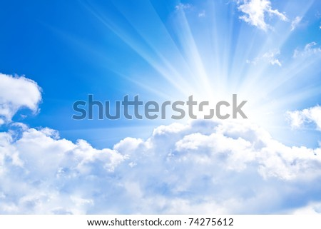 Beams through clouds - stock photo