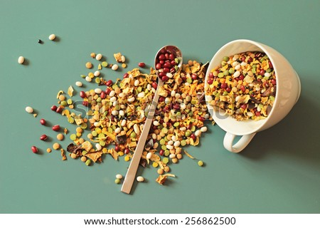 bean and peas mix, spoon and white cup - stock photo