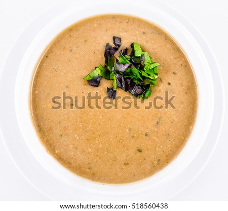 Bean cream soup in white plate. Top view