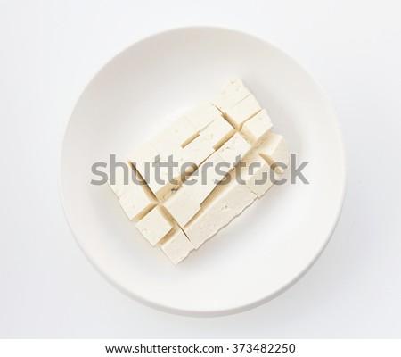 bean curd tofu on dish top view - stock photo