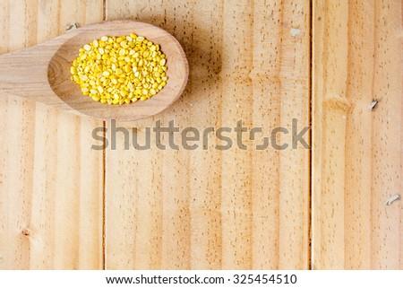 Bean on wooden spoon - stock photo