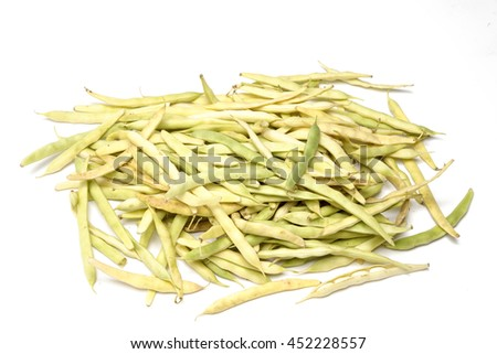 Bean pods with white beans on white background