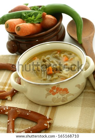 bean soup and fresh vegetables  - stock photo