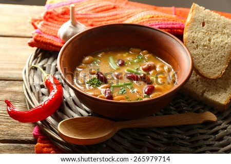 Bean soup in bowl on wooden table background - stock photo