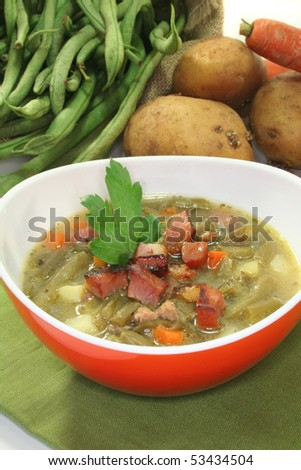 Bean soup with roasted bacon and lovage