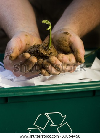 Bean sprout showing recycle bin - stock photo