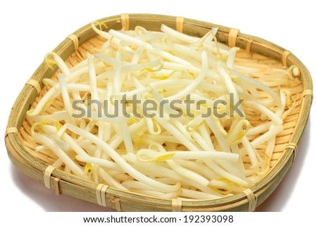 Bean sprouts in a shallow, square bamboo basket. - stock photo