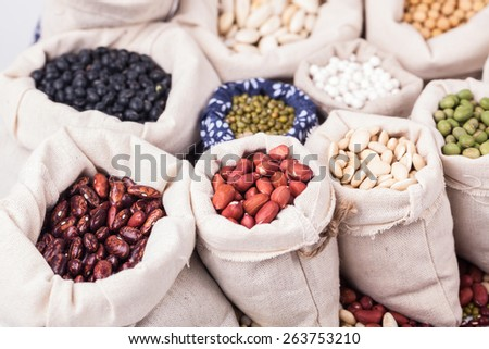 beans and cereals in bag studio shot - stock photo