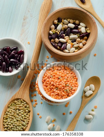 Beans and lentil on a wooden table . selective focus