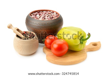 beans in pot and vegetables isolated on white - stock photo