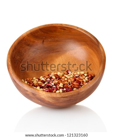 Beans in wooden bowl isolated on white - stock photo