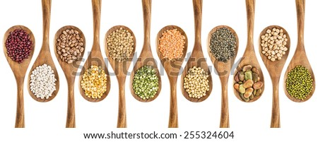 beans, lentils and pea - a collection of food ingredient on isolated wooden spoons - stock photo