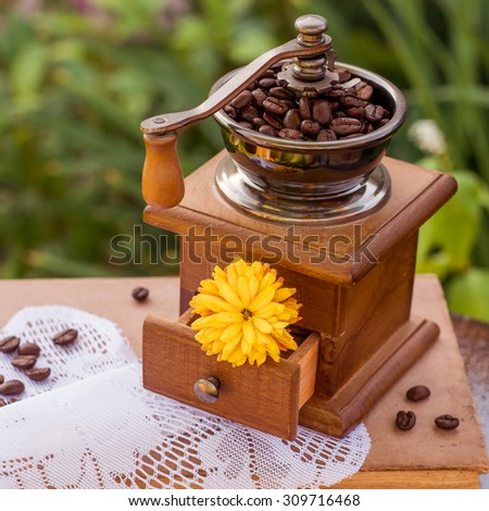 beans of coffee on vintage wooden background - stock photo