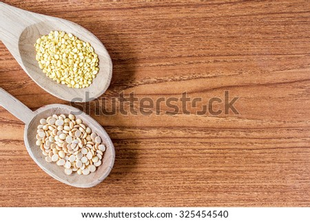 Beans on wooden spoons - stock photo