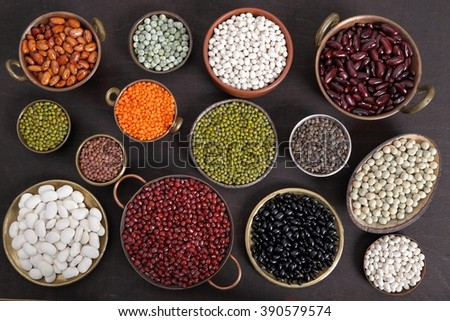 Beans, peas and lentils in metal bowls. - stock photo