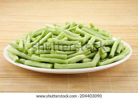 Beans slices in white  plate.