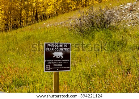 Bear Country warning sign in the Rocky Mountains of Colorado on sunny fall afternoon - stock photo