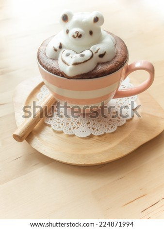 Bear hugging heart in coffee cup. Adorable latte art 3d design. - stock photo