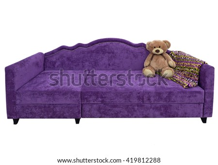 Bear on the soft purple couch - stock photo