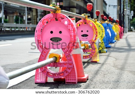 Bear-shaped post of barricade at construction site, Japan - stock photo