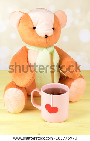 Bear toy on table on light background - stock photo