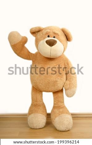 Bear toy waving hello - stock photo