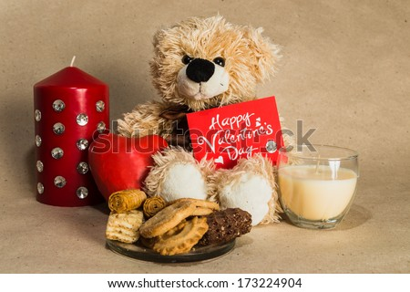 bear with a red heart and a postcard - stock photo