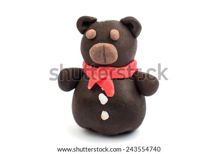 bear with marshmallows on a white background - stock photo