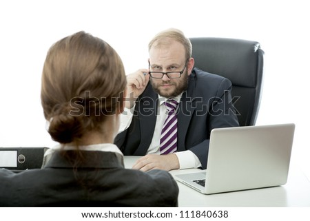 beard business man brunette woman at desk looking serious - stock photo