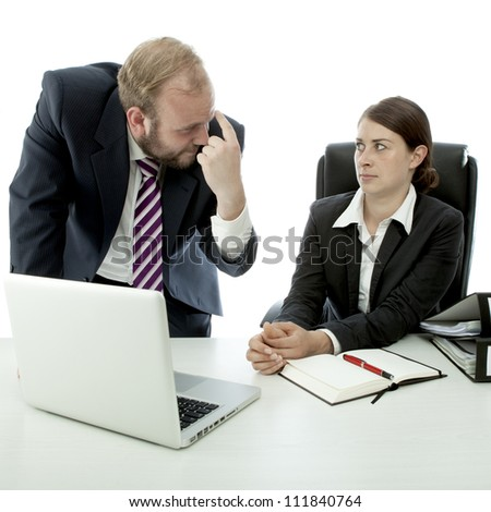 beard business man brunette woman at desk think employee stupid