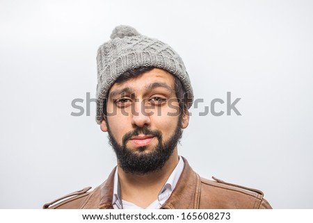 beard man in front of a white background