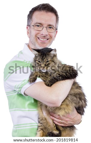 bearded adult male embracing a maine coon cat - stock photo