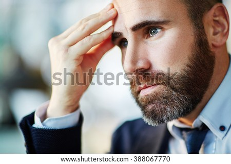 Bearded businessman contemplating about something - stock photo