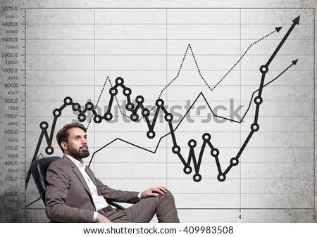 Bearded businessman sitting next to concrete wall with business chart - stock photo