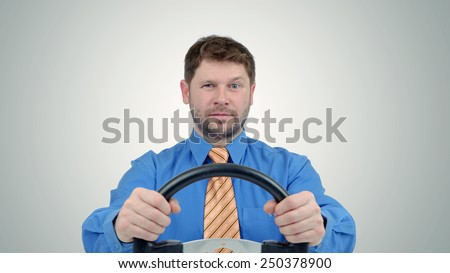 Bearded businessman with a steering wheel, auto business concept  - stock photo