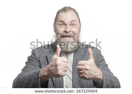 "Bearded funny man in grey jacket shows ""Big finger"" sign"