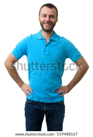 Bearded guy wearing blue polo shirt standing with hands on hips. Isolated