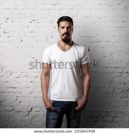 Bearded handsome man wearing white blank t-shirt - stock photo