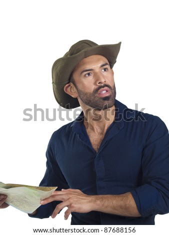 Bearded hiker wearing a hat and holding a map