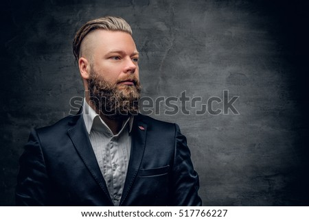 Bearded hipster male in purple suit isolated  on grey vignette background.