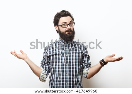 Bearded hipster young man wearing glasses doubting with his hands isolated on white background - stock photo