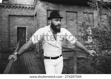 bearded italian boss smoke the cigar, black and white - stock photo