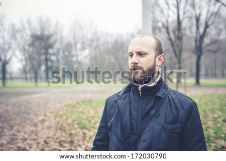 bearded man at the park in winter