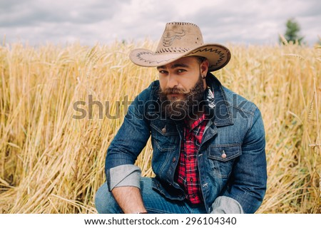 Bearded man. Cowboy - stock photo