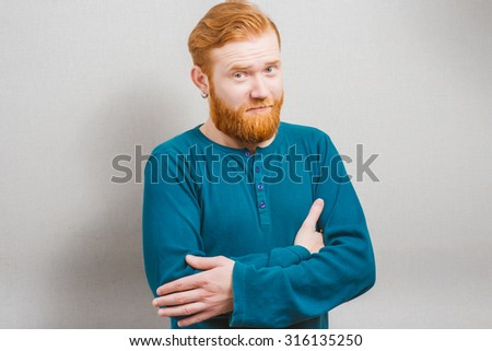 bearded man folded his hands