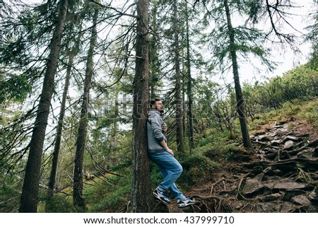 bearded man hiker hipster  in mountain green forest - stock photo
